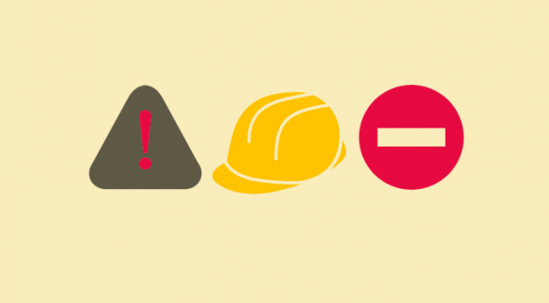 hazard symbols and hard yellow hat