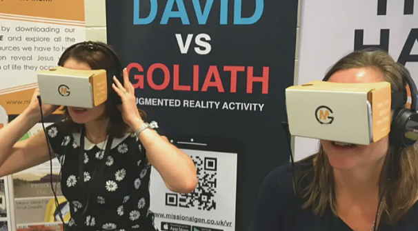 Two women using virtual reality headsets provided by Missional Generation