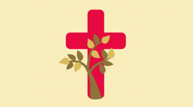plant entwined around a cross